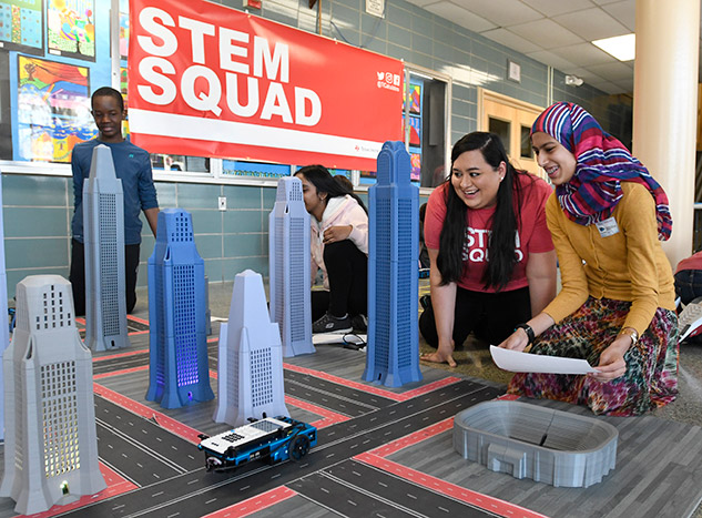 Students move the TI-Innovator™ Rover through tall buildings.
