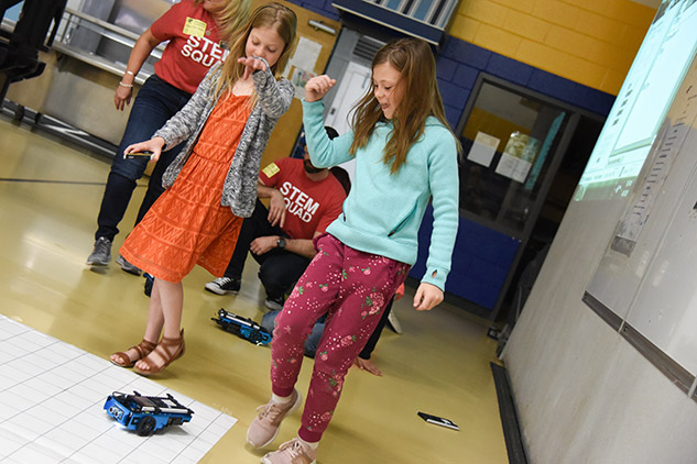 Students dance with TI-Innovator™ Rover.