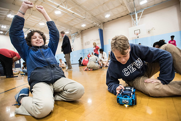 Students in gym interact with TI-Innovator™ Rover